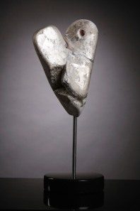 Shadow - rose alabaster, silver and gold leaf on granite